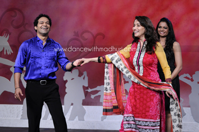 Savio teaches Madhuri how to Salsa and you can learn too! Only on DancewithMadhuri.com